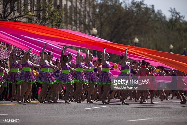 Performers dance during the opening of the National Cherry Blossom Festival and Parade in Washington USA on April 11 2015