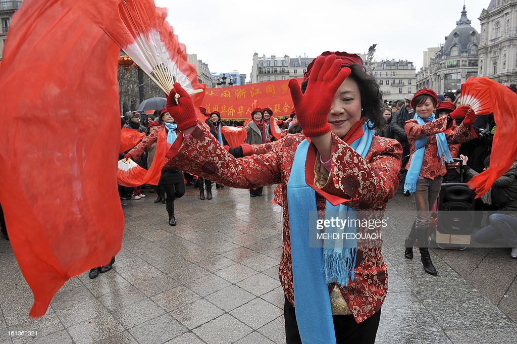 Performers dance in front of Paris City Hall to celebrate Chinese New Year on February 10, 2013, before parading in Paris' streets. Chinese communities world wide traditionally welcomed in the 'Year of the Snake'.