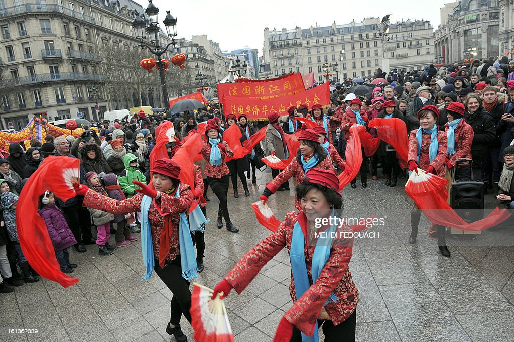 Performers dance in front of Paris City Hall to celebrate Chinese New Year on February 10, 2013, before parading in Paris' streets. Chinese communities world wide traditionally welcomed in the 'Year of the Snake'. AFP PHOTO / MEHDI FEDOUACH