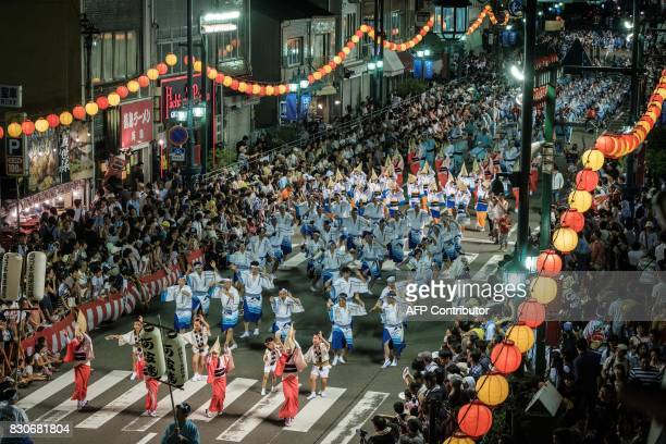 Performers dance in the street during the Awa Odori festival in Tokushima on August 12 2017 The fourday dance festival attracts more than 12 million...