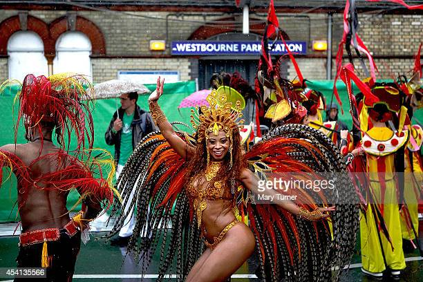 Performers dance through the rain during the Notting Hill Carnival by on August 25th 2014 in London England Despite the bad weather over 1 million...
