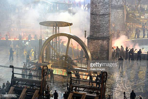 Performers depict the industrial revolution during the Opening Ceremony of the London 2012 Olympic Games at the Olympic Stadium on July 27 2012 in...
