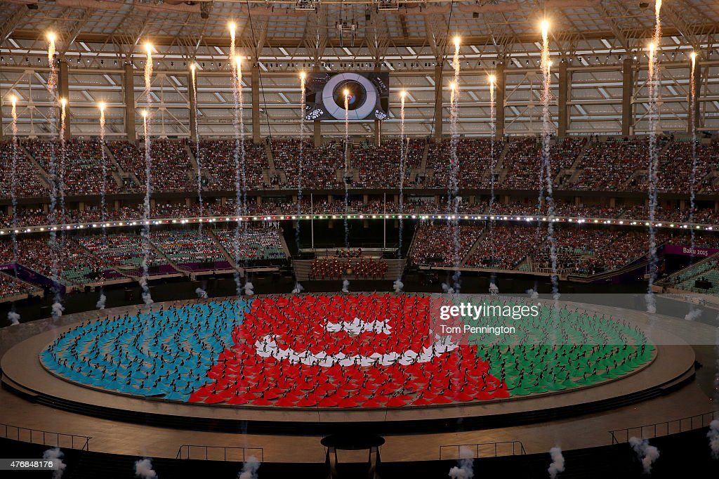 Performers depict the national flag of Azerbaijan during the Opening Ceremony for the Baku 2015 European Games at the Olympic Stadium on June 12 2015...