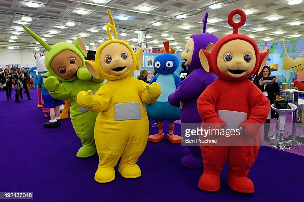 Performers dressed as Dipsy LaaLaa Tinky Winky and Po from the cartoon The Teletubbies prepare before the Brand Licensing Europe character parade at...