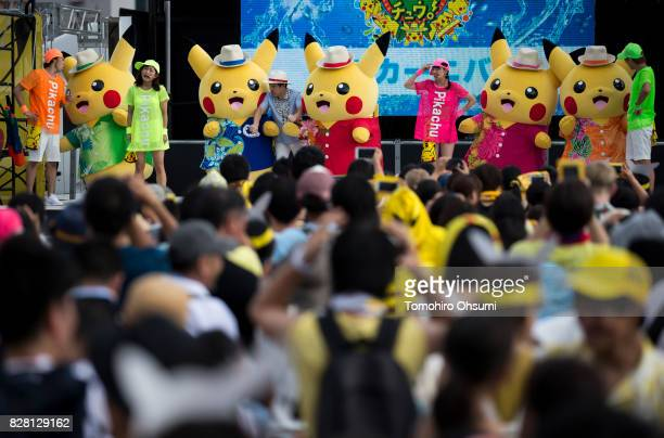 Performers dressed as Pikachu a character from Pokemon series game titles dance on the stage during the Pikachu Outbreak event hosted by The Pokemon...