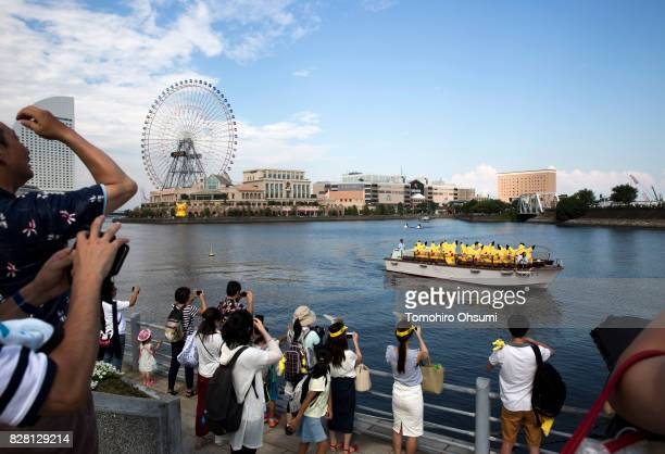 Performers dressed as Pikachu a character from Pokemon series game titles ride on a boat during the Pikachu Outbreak event hosted by The Pokemon Co...