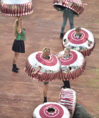 Performers dressed as Tunnocks chocolate teacakes a renowned Scottish confectionary perform during the opening ceremony of the 2014 Commonwealth...