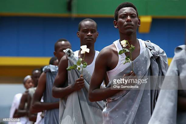 Performers enter Amahoro Stadium during the commemoration of the 20th anniversary of the 1994 genocide April 7 2014 in Kigali Rwanda Tens of...
