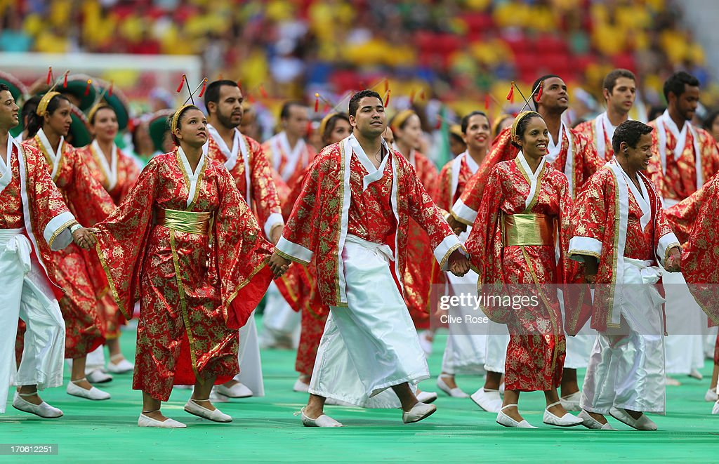 Performers entertain the crowd during the Opening Ceremony prior to the FIFA Confederations Cup Brazil 2013 Group A match between Brazil and Japan at National Stadium on June 15, 2013 in Brasilia, Brazil.
