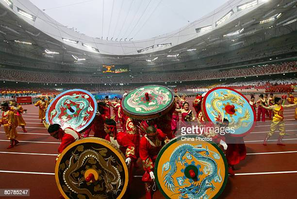 Performers form the Olympic Five Rings with huge diabolos during the 'Good Luck Beijing' 2008 Beijing International Marathon Race at the National...