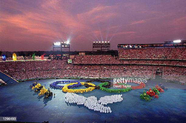 Performers form the Olympic Rings during the Opening Ceremonies of the 1996 Olympic Games on July 19 1996 at Olympic Stadium in Atlanta Georgia