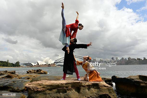 Performers from a Chinese ballet company Zhang Yashu Tang Chenglong and Mi Xia perform during a photo shoot in front of the Australia's iconic...