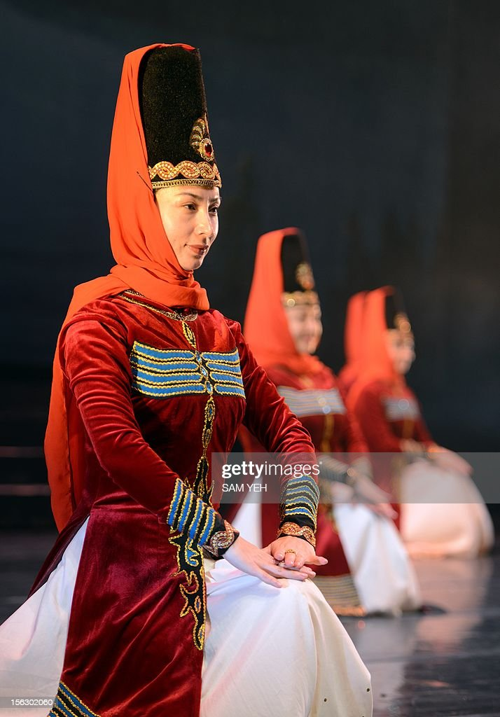 Performers from an art group in China's Xinjiang province dance during a press conference in Taipei on November 13, 2012. More then fifty performers were invited by the Taiwanese government's Mongolian and Tibetan Affairs Commission for culture exchange between November 13 to 23 to perform at Taipei, Miaoli, Kaohsiung, Hualien and Taitung. AFP PHOTO / Sam Yeh