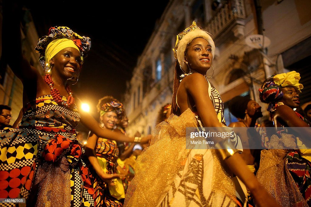 Performers from Grupo Orunmila smile after dancing at National Day of Samba celebrations at Pedra do Sal in the port district on December 2 2013 in...