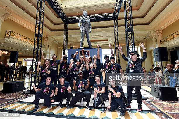 Performers from 'Michael Jackson ONE by Cirque du Soleil' pose in front of Michael Jackson's 10foottall HIStory statue after is was unveiled at the...