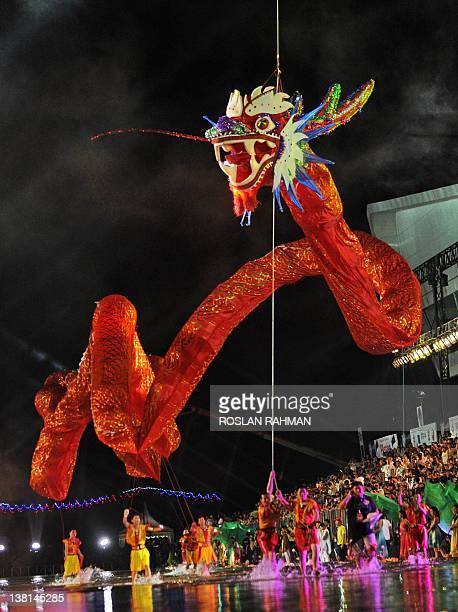 Performers from Shaanxi make their way down a specially constructed 360 metre waterway with a 'Flying Dragon' at the annual Chinese New Year Chingay...