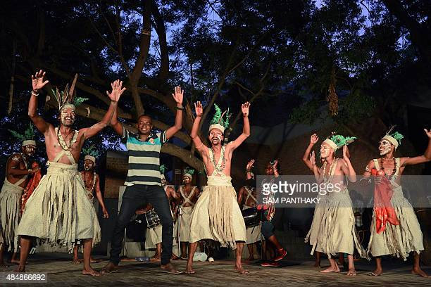 Performers from the Siddi community of Gujarat including a guest from Sudan take part in a Siddi Dhamal dance at a cultural performance in Ahmedabad...