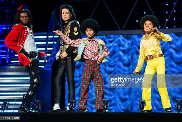 Performers from the 'Thriller Live' stage show pose on stage with Waxwork figures of Michael Jackson as Madame Tussauds unveil 3 new Michael Jackson...