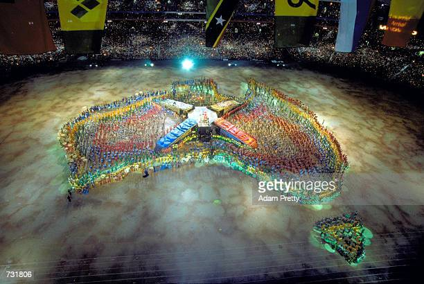 Performers gather to create a map of Australia September 15 2000 during the opening ceremony of the Sydney 2000 Olympic Games at the Olympic Stadium...
