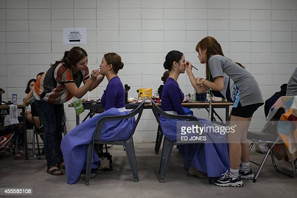 Performers have their makeup applied backstage prior to a rehearsal for the opening ceremony of the 2014 Asian Games at the main stadium venue in...