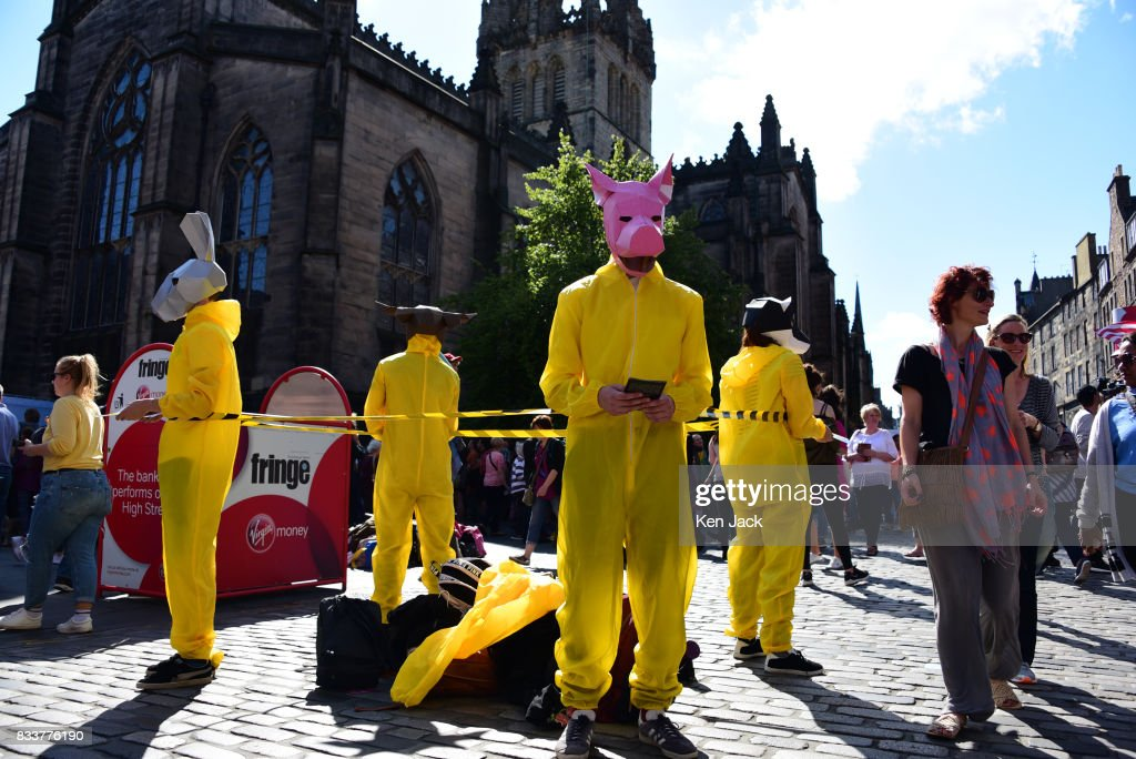 Performers in costume promote a show on the Royal Mile during the Edinburgh Festival Fringe, on August 17, 2017 in Edinburgh, Scotland. The Fringe is celebrating its 70th year, and this year hosts over three thousand shows and more than 50,000 performances.
