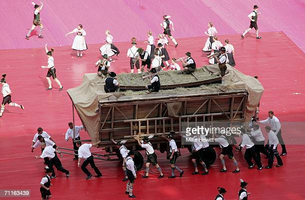 Performers in traditional German outfits take part during the FIFA World Cup Germany 2006 Opening Ceremony prior to the Group A match between Germany...