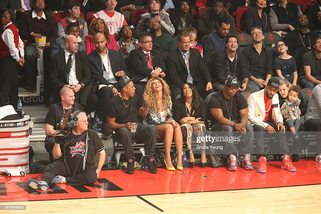 Performers Jay-Z and his wife Beyoncé Knowles watch the 2013 NBA All-Star Game from the sidelines on February 17, 2013 at Toyota Center in Houston, Texas.