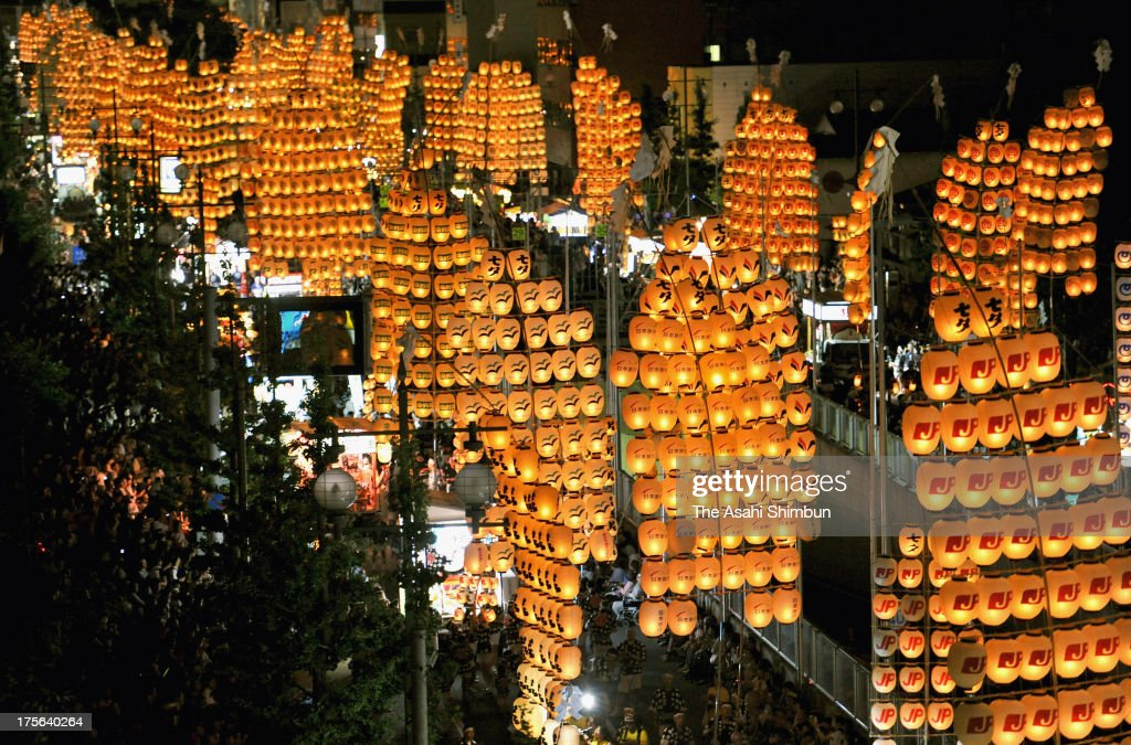 Performers march carrying lanterns hanging from poles during the Akita Kanto Festival on August 3, 2013 in Akita, Japan. The biggest pole is 12-meter-high, 50-kilogram with hunging 46 lanterns. The four day festival is expected to attract more than 1.35 million people.