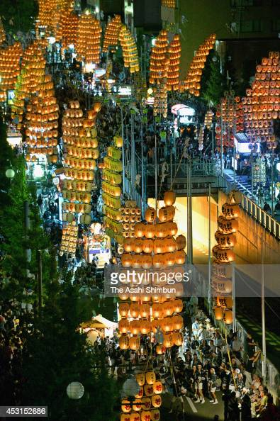 Performers march carrying lanterns hanging from poles during the Akita Kanto Festival on August 3 2014 in Akita Japan A record 270 bamboo poles...