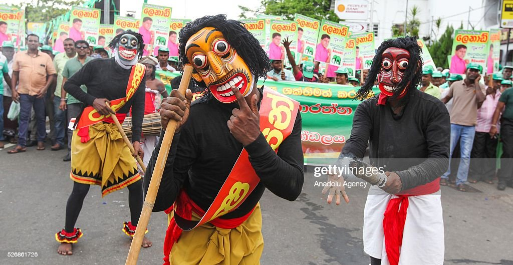 Performers march during a rally to mark International Labor Day in Colombo, on May 1, 2016.