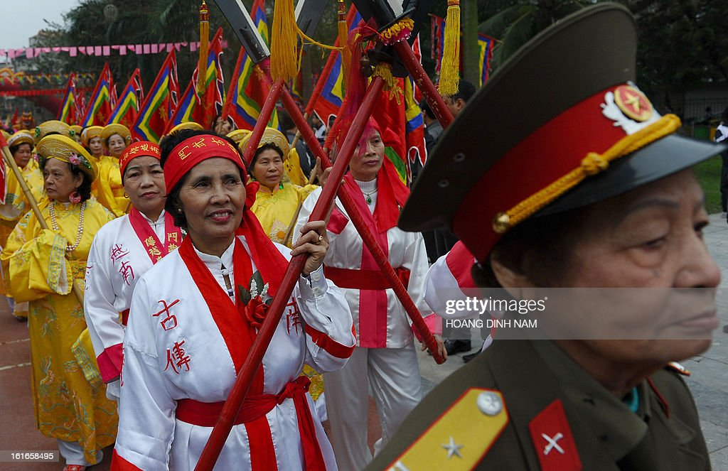 Performers march in procession during a ceremony to mark the 224th anniversary of Vietnam's Dong Da victory over Chinese invading troops in the spring of 1789 at the site of the historical battlefield in Hanoi on February 14, 2013. AFP PHOTO/HOANG DINH Nam
