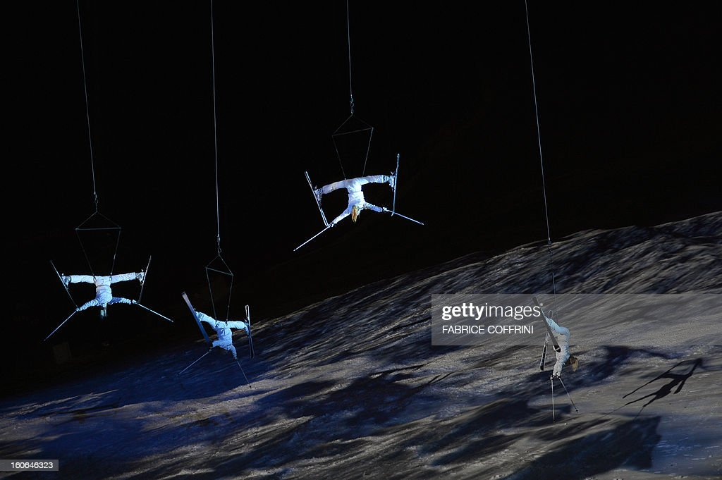 Performers on skies hang from wires during the opening ceremony of the FIS World Ski Championships on February 4, 2013 in Schladming.