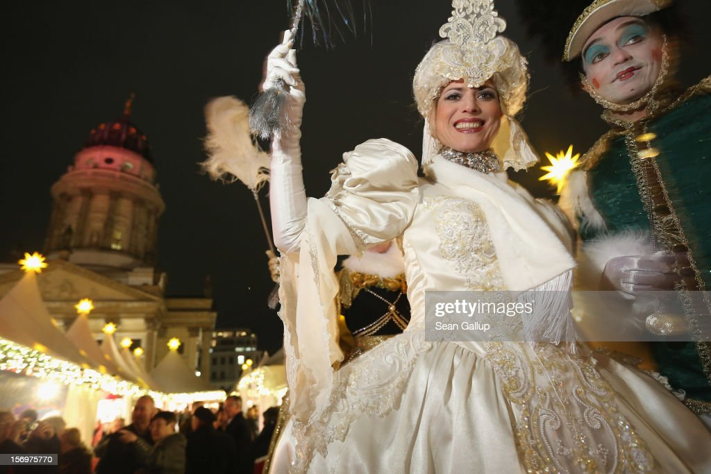 Performers on stilts walk among visitors at the annual Christmas market at Gendarmenmarkt on its opening day on November 26, 2012 in Berlin, Germany. Christmas markets, with their stalls selling mulled wine, Christmas tree decorations and other delights, are an integral part of German Christmas tradition, and many of them opened across Germany today.