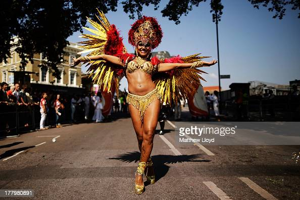 Performers parade past the judges position at the start of the Notting Hill Carnival on August 26 2013 in London England More than one million people...