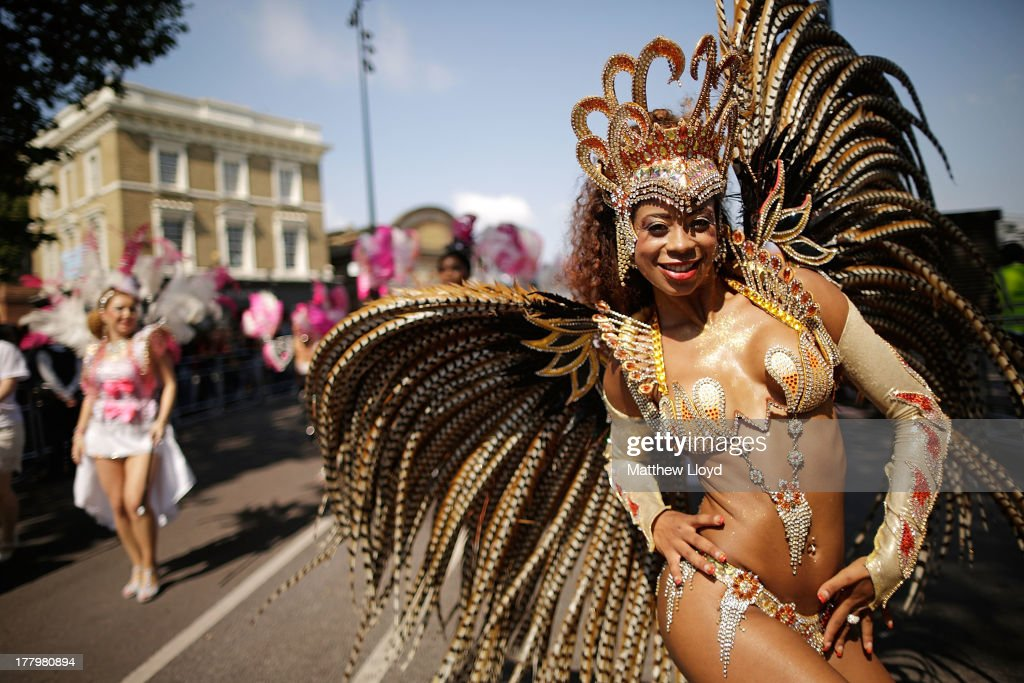 Performers parade past the judges position at the start of the Notting Hill Carnival on August 26, 2013 in London, England. More than one million people are expected to enjoy this year's Notting Hill Carnival. It is the largest street festival in Europe and was first held in 1964 by the Afro-Caribbean community. Over the bank holiday weekend the streets come alive to steel bands, colourful floats and costumed performers as members of the public flood into the area to join in the celebrations.