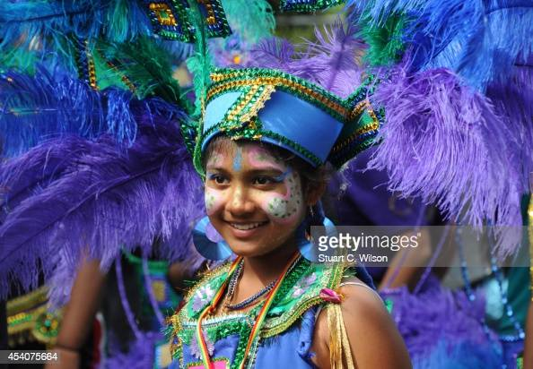 Performers parade through the streets of West London during the Notting Hill carnival on August 24 2014 in London England