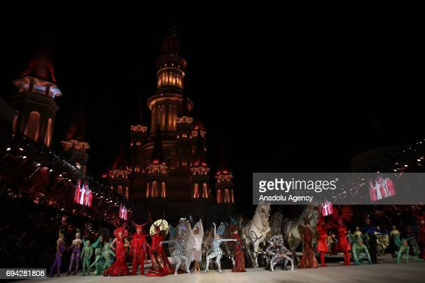 Performers perform a show during a miniconcert within the Dosso Dossi Fashion Show in Antalya Turkey on June 09 2017