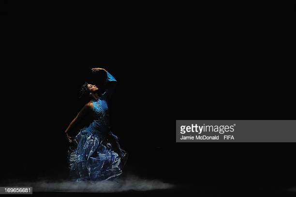 Performers perform The Four Elements during the 63rd FIFA Congress opening ceremomy at the Swami Vivekananda International Convention Centre on May...