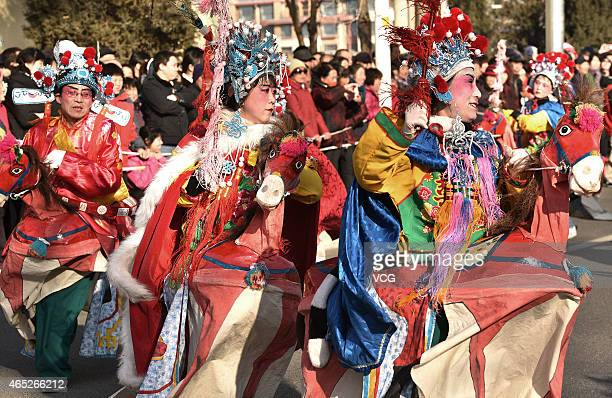 Performers put on a show to celebrate the Lantern Festival on March 5 2015 in Beijing China Folklore performance was carried out to celebrate the...