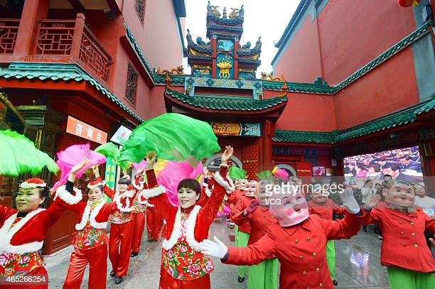 Performers put on a show to celebrate the Lantern Festival on March 5 2015 in Changsha Hunan province of China Folklore performance was carried out...