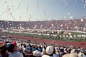 Performers release hundreds of white balloons in the sky during the opening ceremony Many communist nations boycotted the Games that year notably the...