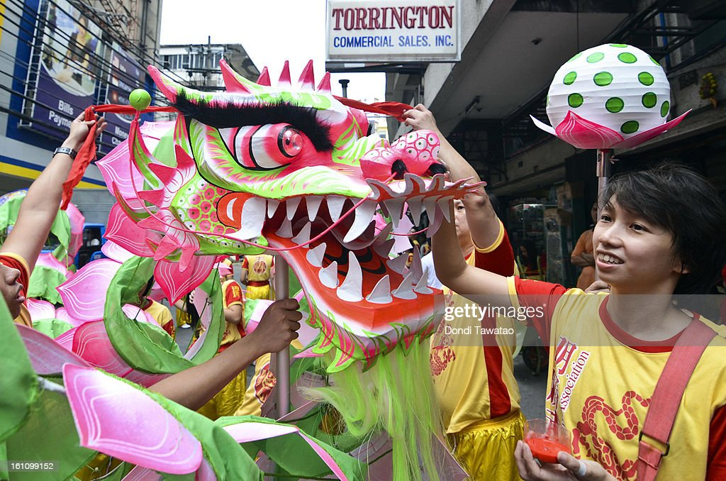 Performers remove blindfolds on a Chinese lotus dragon as a form of blessing during the celebration of the Chinese New Year in the district of Binondo on February 9, 2013 in Manila, Philippines. Only after being fitted with eyelids can a dragon 'come to life', according to traditional Chinese dragon makers. The Chinese New Year begins tomorrow and this year is the year of the snake, known by locals as 'Spring Festival' or 'Lunar New Year' it is celebrated annually by Chinese Filipinos who make up roughly 20 percent of the local population.