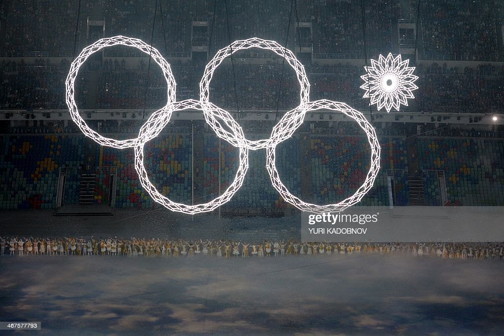 Performers sing as the Olympic rings are presented during the Opening Ceremony of the Sochi Winter Olympics at the Fisht Olympic Stadium on February 7, 2014 in Sochi. AFP PHOTO / YURI KADOBNOV