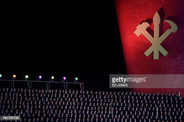 Performers sing before a backdrop during an open air dance and music performance on the North bank of the Taedong river in Pyongyang on October 11...