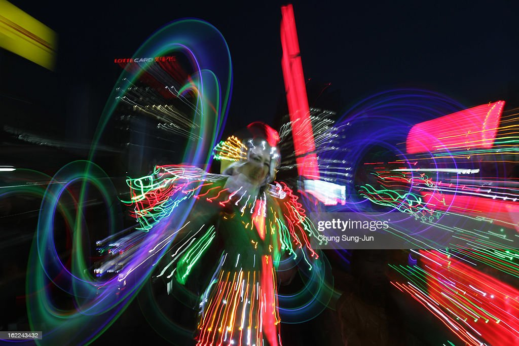 Performers spin illuminated sticks during 'Cyber Jwibulnoli' at Everland on February 21, 2013 in Seoul, South Korea. Jwibulnoli is originally played on the first full moon of the lunar year, that is February 25 this year.