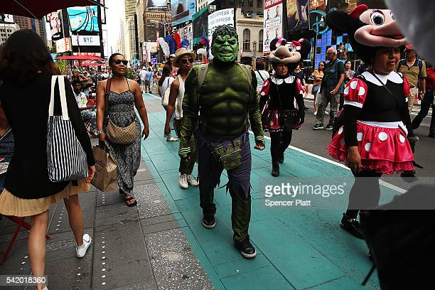 Performers stand in the green box in Times Square on the first day that the new rules for performers in Times Square went into effect on June 21 in...