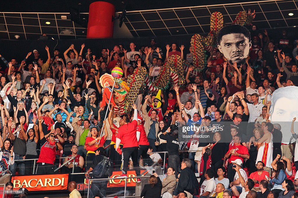 Performers take a Chinese dragon through the stands to celebrate Chinese New Year during a game between the Portland Trail Blazers and Miami Heat on February 12, 2013 at American Airlines Arena in Miami, Florida.
