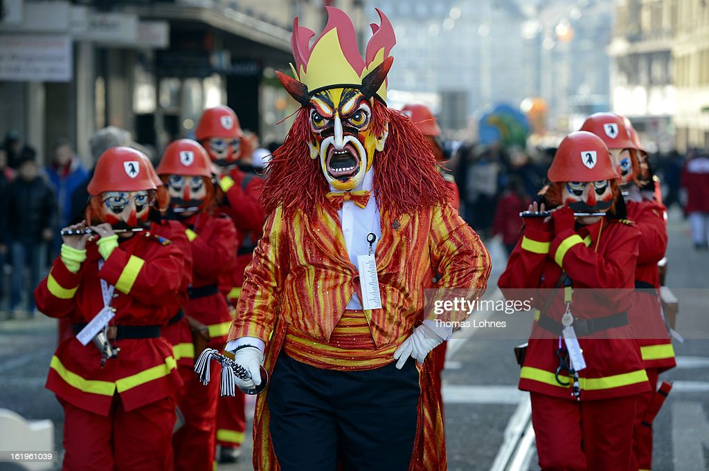 Performers take part at the 'cotage' of the Basel Fasnacht Carnival on February 18, 2013 in Basel, Switzerland. More than 12,000 participants will take part in the largest carnival in Switzerland that lasts for 72 hours and will be watched by more than 100,000 spectators as it makes its way through the city center.