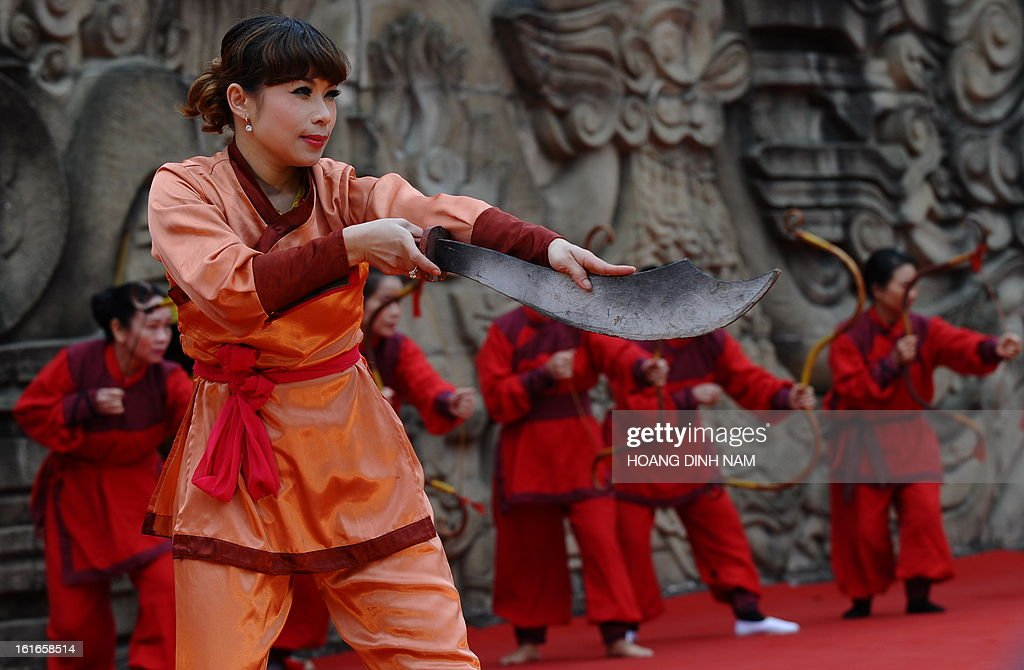 Performers take part in a ceremony to mark the 224th anniversary of Vietnam's Dong Da victory over Chinese invading troops in the spring of 1789 at the site of the historical battlefield in Hanoi on February 14, 2013. AFP PHOTO/HOANG DINH Nam