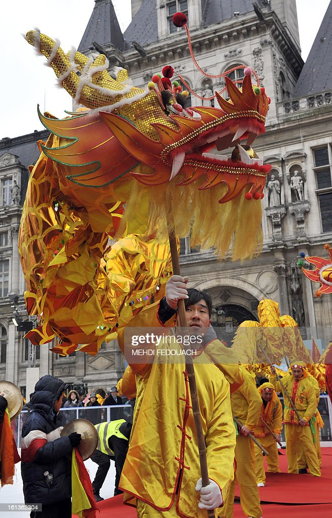 Performers take part in a dragon dance in front of Paris City Hall to celebrate Chinese New Year on February 10, 2013, before parading in Paris' streets. Chinese communities world wide traditionally welcomed in the 'Year of the Snake'.